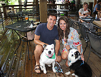 Daryl Ottaviano and Jenny Skelton, with Ava (left) and Harper help support the Humane Society of the Ozarks on Aug. 2 at Sassafras. <br /> (NWA Democrat-Gazette/Carin Schoppmeyer)