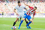 Juan Francisco Torres Belen, Juanfran (r), of Atletico de Madrid challenges Victor Machin Perez, Vitolo, of Sevilla FC during their La Liga match between Atletico de Madrid and Sevilla FC at the Estadio Vicente Calderon on 19 March 2017 in Madrid, Spain. Photo by Diego Gonzalez Souto / Power Sport Images
