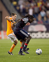 New England Revolution midfielder Shalrie Joseph (21) attempts to control the ball as Houston Dynamo defender Richard Mulrooney (8) pressures. The New England Revolution defeated Houston Dynamo, 1-0, at Gillette Stadium on August 14, 2010.