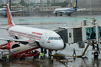 INDIA, Mumbai , Chatrapati Shivaji International Airport, Airbus of Air India and behind aircraft of Jet Airways