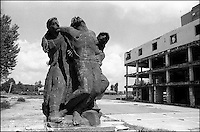 The main square in Vukovar is mostly empty and still scarred from fighting, but it still holds this statue of three Yugoslav partisans. The partisans, seen as folk heros by many, helped defeat the Nazis and along with Josip Broz Titio, helped create what used to be known as Yugoslavia. Vukovar, Croatia, August 2000 © Stephen Blake Farrington<br />
