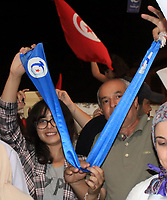 06 October 2019, Tunisia, Tunis: Supporters of Islamist Ennahda Party, take part in a celebration event in-front of the party headquarters after the party gained most votes according to an exit poll by Sigma Conseil which was broadcasted by the Tunisian state television, during the Tunisian parliamentary election. Photo