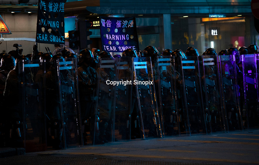 Police warn that tear gas will be fired to clear protestors during a road clearance in Mong Kok, Kowloon, Hong Kong, China, 04 August 2019.