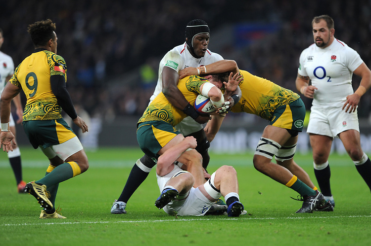 Maro Itoje of England tackles Michael Hooper (c) of Australia during the Quilter International match between England and Australia at Twickenham Stadium on Saturday 24th November 2018 (Photo by Rob Munro/Stewart Communications)