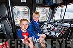 Ollie and Charlie Enright from Carragh Lake on board the launch at the Fenit RNLI open day in Fenit on Sunday