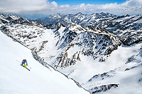 The Ortler Group in northern Italy is a popular region for spring ski touring using the huts for overnights to ski all the many peaks in the mountain group. Skiing the steep south face of the Gran Zebru/Königspitze, 3851 meters.