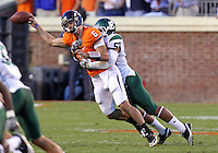 Oct 23, 2010; Charlottesville, VA, USA;  Virginia Cavaliers quarterback Marc Verica (6) is tackled by Eastern Michigan Eagles linebacker Tim Fort (57) during the 1st half of the game at Scott Stadium.  Mandatory Credit: Andrew Shurtleff