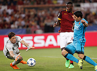 Calcio, Champions League, Gruppo E: Roma vs Barcellona. Roma, stadio Olimpico, 16 settembre 2015.<br /> Roma's goalkeeper Wojciech Szczesny, left, assisted by teammate Antonio Ruediger, center, grabs the ball  against FC Barcelona's Luis Suarez, during a Champions League, Group E football match between Roma and FC Barcelona, at Rome's Olympic stadium, 16 September 2015.<br /> UPDATE IMAGES PRESS/Isabella Bonotto
