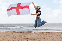 BNPS.co.uk (01202) 558833. <br /> Pic: CorinMesser/BNPS<br /> <br /> Pictured: Mya Punter-Bradshaw, 21, flying the flag for England. <br /> <br /> England fans visiting the beaches of Bournemouth, Dorset show their support for the team ahead of the Euro 2020 semi-final against Denmark