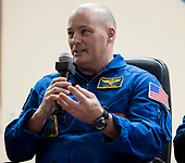 Expedition 54 flight engineer Scott Tingle of NASA answers a question during a press conference, Saturday, December 16, 2017 at the Cosmonaut Hotel in Baikonur, Kazakhstan. Tingle, Soyuz Commander Anton Shkaplerov of Roscosmos, and flight engineer Norishige Kanai of Japan Aerospace Exploration Agency (JAXA) are scheduled to launch to the International Space Station aboard the Soyuz spacecraft from the Baikonur Cosmodrome on December 17.  <br /> Mandatory Credit: Joel Kowsky / NASA via CNP
