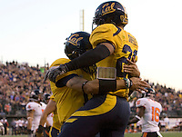 Zach Maynard of California celebrates with Isi Sofele of California after Maynard scored a touchdown during the game against Oregon State at AT&T Park in San Francisco, California on November 12th, 2011.   California defeated Oregon State, 23-6.