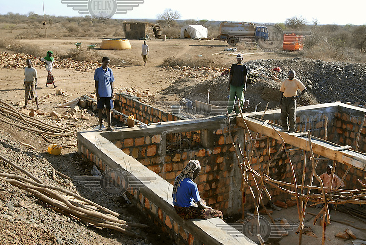 Builders construct a Birkat, a traditional underground water storage basin funded by the International Committee of the Red Cross.  A severe drought has extended across East Africa after the rainy season which was expected in October 2005 failed to arrive.  Levels of rainfall in the region have been far below normal putting millions of lives at risk.  Most rural dwellers in the southernmost area of the country rely on two rainy seasons and two dry seasons per year...