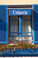 Harbour side restauarants signs - Creperie. Honfleur, Normandy, France.