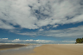Ilheus, Bahia State, Brazil. Southern beaches. Wide expanse of sea and sand with scudding clouds.