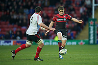 20121216 Copyright onEdition 2012©.Free for editorial use image, please credit: onEdition..Owen Farrell of Saracens chips ahead past James Coughlan of Munster Rugby during the Heineken Cup Round 4 match between Saracens and Munster Rugby at Vicarage Road on Sunday 16th December 2012 (Photo by Rob Munro)..For press contacts contact: Sam Feasey at brandRapport on M: +44 (0)7717 757114 E: SFeasey@brand-rapport.com..If you require a higher resolution image or you have any other onEdition photographic enquiries, please contact onEdition on 0845 900 2 900 or email info@onEdition.com.This image is copyright onEdition 2012©..This image has been supplied by onEdition and must be credited onEdition. The author is asserting his full Moral rights in relation to the publication of this image. Rights for onward transmission of any image or file is not granted or implied. Changing or deleting Copyright information is illegal as specified in the Copyright, Design and Patents Act 1988. If you are in any way unsure of your right to publish this image please contact onEdition on 0845 900 2 900 or email info@onEdition.com