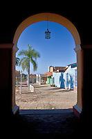 Cuba, Trinidad.   Plaza Mayor through a Portal of the Palacio Brunet, now the Museo Romantico.