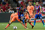 Crystal Palace midfielder Wilfried Zaha (C) competes for the ball with Liverpool players during the Premier League Asia Trophy match between Liverpool FC and Crystal Palace FC at Hong Kong Stadium on 19 July 2017, in Hong Kong, China. Photo by Yu Chun Christopher Wong / Power Sport Images