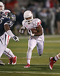 Fresno State's T.J. Thomas (24) rushes past Nevada defender Rykeem Yates (55) during the second half of an NCAA college football game in Reno, Nev., on Saturday, Nov. 22, 2014. Fresno State won 40-20. (AP Photo/Cathleen Allison)