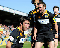 Hugo Southwell of London Wasps (left) celebrates scoring with team mates Nick Robinson (right) and Richard Haughton of London Wasps during the Aviva Premiership match between London Wasps and Gloucester Rugby at Adams Park on Sunday 1st April 2012 (Photo by Rob Munro)