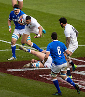 13th February 2021; Twickenham, London, England; International Rugby, Six Nations, England versus Italy; Anthony Watson of England jumps to avoid a tackle