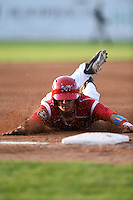 Batavia Muckdogs shortstop Aaron Blanton (11) slides safely into third during a game against the Jamestown Jammers on July 25, 2014 at Dwyer Stadium in Batavia, New York.  Batavia defeated Jamestown 7-2.  (Mike Janes/Four Seam Images)
