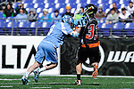 Face-Off Classic:  Midfielder Greg McBride #3 of the North Carolina Tar Heels checks on Attackmen Alex Capretta # 33 of the Princeton Tigers during the Princeton v North Carolina mens lacrosse game at M&T Bank Stadium on March 10, 2012 in Baltimore, Maryland.(Ryan Lasek/Eclipse Sportswire)