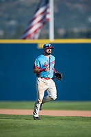 Spokane Indians left fielder Tanner Gardner (44) jogs off the field between innings of a Northwest League game against the Vancouver Canadians at Avista Stadium on September 2, 2018 in Spokane, Washington. The Spokane Indians defeated the Vancouver Canadians by a score of 3-1. (Zachary Lucy/Four Seam Images)