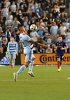 KANSAS CITY, KS - SEPTEMBER 11: Alan Pulido #9 of Sporting Kansas City controls the ball in midfield during a game between Chicago Fire FC and Sporting Kansas City at Children's Mercy Park on September 11, 2021 in Kansas City, Kansas.