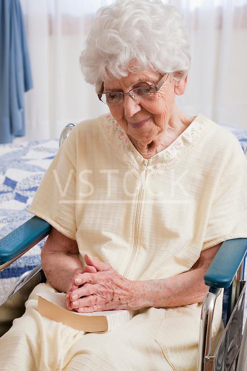 USA, Illinois, Metamora, Senior woman on wheelchair praying