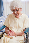 USA, Illinois, Metamora, Senior woman on wheelchair praying