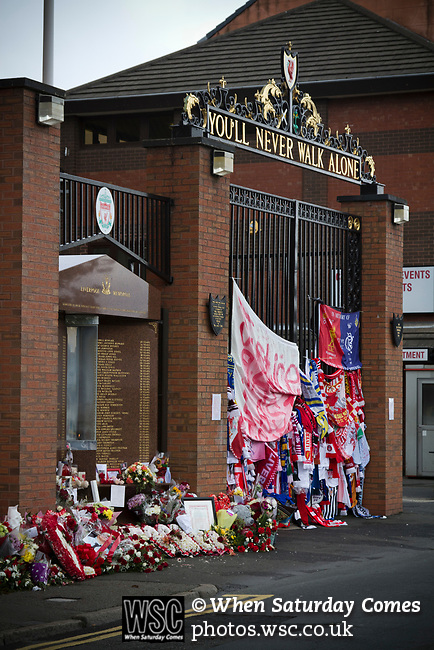 Mementos, wreaths and scarves placed Shankly Gates and the memorial at Anfield in memory to the 1989 Hillsborough stadium disaster where 96 Liverpool football fans lost their lives. Mourners and well-wishers have been leaving flowers, scarves and wreaths after the publication of a report the previous week by the Hillsborough Independent Panel which released new information about the tragedy. The Hillsborough Justice Campaign had been campaigning for a new inquest into the disaster for the last 23 years. Photo by Colin McPherson.