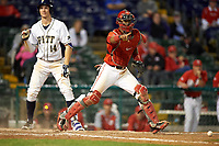 Ohio State Buckeyes catcher Jalen Washington (2) points to first after blocking a pitch with Charles LeBlanc (14) batting during a game against the Pitt Panthers on February 20, 2016 at Holman Stadium at Historic Dodgertown in Vero Beach, Florida.  Ohio State defeated Pitt 11-8 in thirteen innings.  (Mike Janes/Four Seam Images)