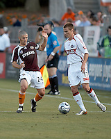 Houston Dynamo defender Wade Barrett (24) attempts to steal the ball from Chicago Fire forward Chris Rolfe (17).  Chicago Fire beat Houston Dynamo 1-0 at Robertson Stadium in Houston, TX on April 29, 2007.