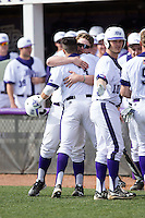 Tim Mansfield (3) of the High Point Panthers gets a hug from teammate JJ Woodard (11) after hitting a home run against the NJIT Highlanders game one of a double-header at Williard Stadium on February 18, 2017 in High Point, North Carolina.  The Panthers defeated the Highlanders 11-0.  (Brian Westerholt/Four Seam Images)