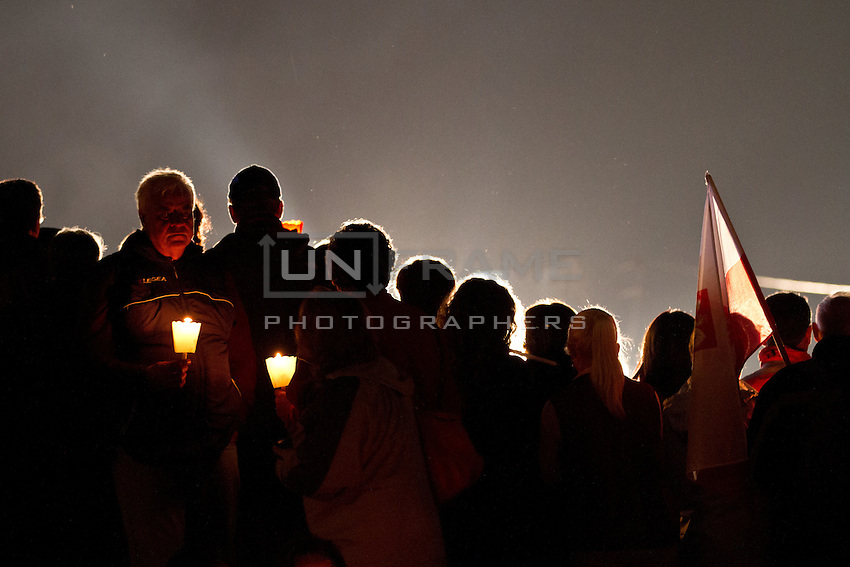Pilgrims hold candles during an evening vigil ahead of the beatification of Pope John Paul ll.