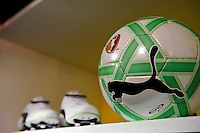 A PUMA soccer ball and a pair of PUMA shoes on display in a locker during the unveiling of the Women's Professional Soccer uniforms at the Event Place in Manhattan, NY, on February 24, 2009. Photo by Howard C. Smith/isiphotos.com