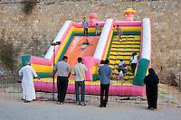 Tripoli, Libya, North Africa - Libyan Children on Amusement Park Air Slide.