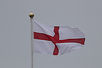 12th July 2021; The Royal St. George's Golf Club, Sandwich, Kent, England; The 149th Open Golf Championship, practice day; the English flag of St George above the 18th green flutters in the breeze on the final hole