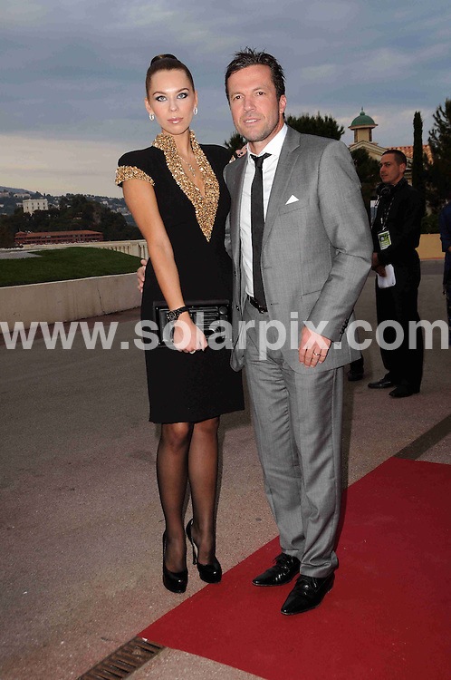 **ALL ROUND PICTURES FROM SOLARPIX.COM**.**WORLDWIDE SYNDICATION RIGHTS**.arrivals for the 2010 World Music Awards, Monte Carlo, Monaco. 18 May 2010..This pic: Lothar Matthaeus and wife Liliana..JOB REF: 11277 MSR    DATE: 18_05_2010.**MUST CREDIT SOLARPIX.COM OR DOUBLE FEE WILL BE CHARGED**.**MUST NOTIFY SOLARPIX OF ONLINE USAGE**.**CALL US ON: +34 952 811 768 or LOW RATE FROM UK 0844 617 7637**