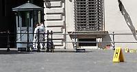Rilievi della Scientifica sul punto della sparatoria nel corso della quale sono rimasti feriti due Carabinieri di fronte a Palazzo Chigi, Roma, 28 aprile 2013..Forensic police collect evidence where a shooting in which two Carabinieri paramilitary police officers were wounded, took place outside Chigi Palace, government office, in Rome, 28 April 2013..UPDATE IMAGES PRESS/Isabella Bonotto