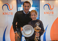 Hilversum, Netherlands, December 4, 2016, Winter Youth Circuit Masters,  winner girls 12 years,  Isis van den Broek with Fedcup captain Paul Haarhuis. <br /> Photo: Tennisimages/Henk Koster