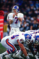 OAKLAND, CA - Quarterback John Elway of the Denver Broncos in action calling a timeout during a game against the Oakland Raiders at the Oakland Coliseum in Oakland, California in 1995. Photo by Brad Mangin