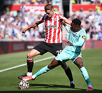 11th September 2021; Brentford Community Stadium, London, England;  Premier League football, Brentford versus Brighton Athletic; Danny Welbeck of Brighton competes for the ball with Kristoffer Ajer of Brentford