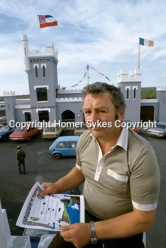 Chief matchmaker and owner of three hotels in Lisdoonvarna holding a marriage certificate 1990s  Southern Ireland.  1990s seen here at The White Castle Hotel.