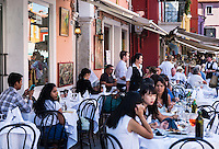 Patrons at an outdoor cafe restaurant, Burano, Venice, Italy
