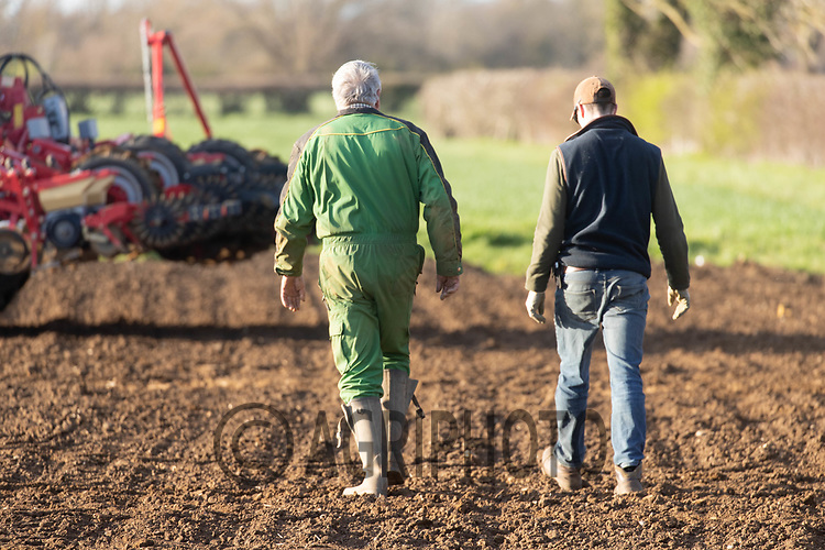 25-3--2021 Two farmers walking across a field <br /> ©Tim Scrivener Photographer 07850 303986<br />      ....Covering Agriculture In The UK....