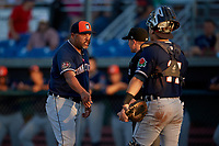 Connecticut Tigers manager Gerald Laird (12) argues a call with umpire Ervin Johnson as catcher Andres Sthormes (14) looks on during a game against the Auburn Doubledays on August 8, 2017 at Falcon Park in Auburn, New York.  Auburn defeated Connecticut 7-4.  (Mike Janes/Four Seam Images)