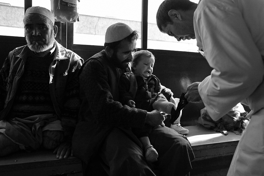 Patients and doctors at the Red Cross run Kabul Orthopedic Clinic in December 2008 where thousands of the victims from Afghanistan's thirty years of conflict come for rehabilitation for lost and ruined limbs caused by disease, injury, mines and unexploded ordinance, and bombings.