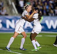 Jamia Fields (4) of Florida State celebrates her goal with teammate Dagny Brynjarsdottir (7) during the Women's College Cup semifinals at WakeMed Soccer Park in Cary, NC. Florida State defeated Virginia Tech, 3-2.