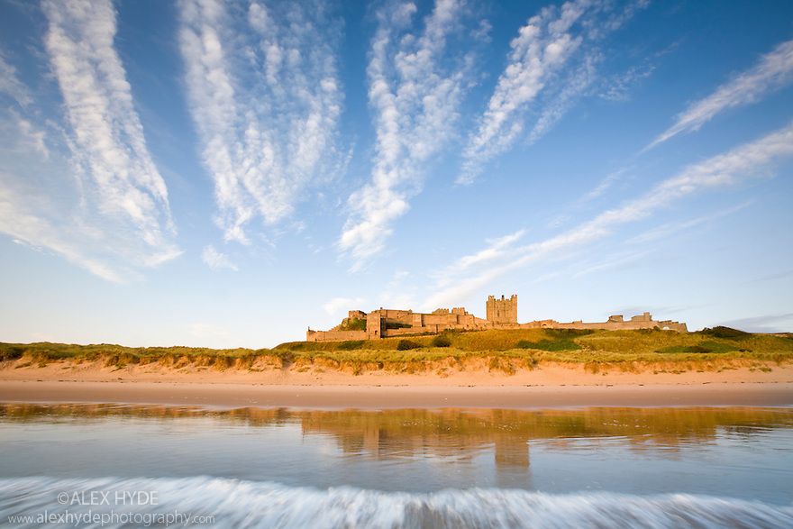Bamburgh Castle shortly after high tide, Northumberland, UK. July.